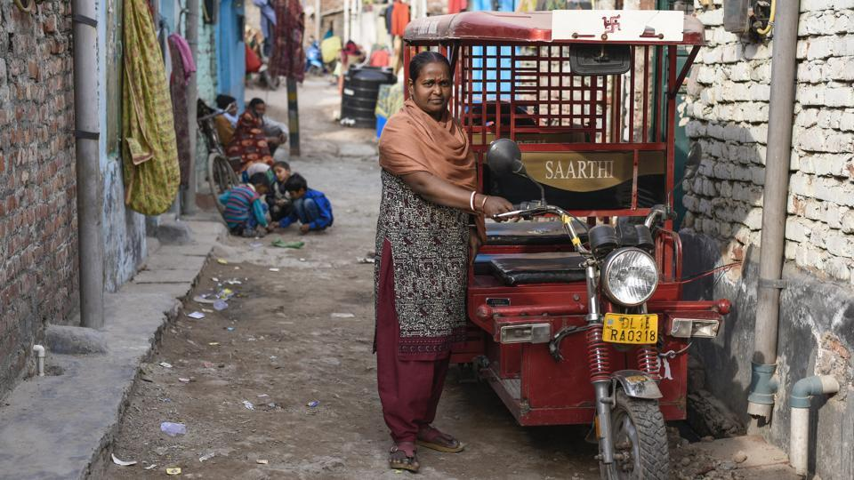 Two years ago, in an move towards financial security, 44-year-old Binota Gayen took out a loan, got herself licensed and became the first woman e-rickshaw driver in Delhi's Govindpuri. As HT photographer Burhaan Kinu documents a day in her life, Binota reminisces about her initial struggles in a male dominated profession and the realisation of a childhood dream. (Burhaan Kinu / HT Photo)