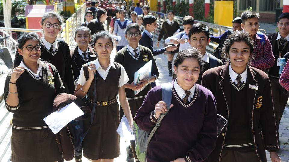 Students leaving the exam centre at SD School, Sector 32, Chandigarh, on Tuesday.