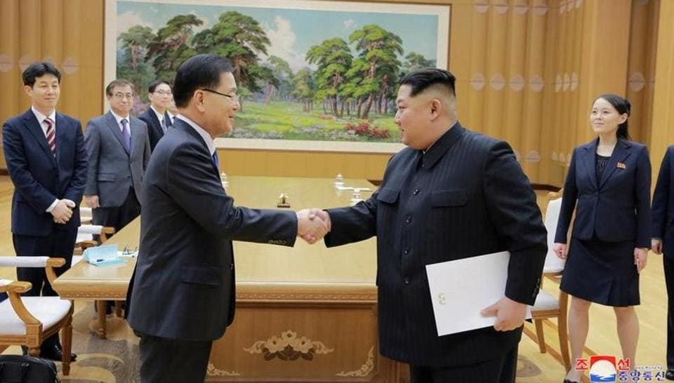 North Korean leader Kim Jong Un shakes hands with a member of the special delegation of South Korea's President