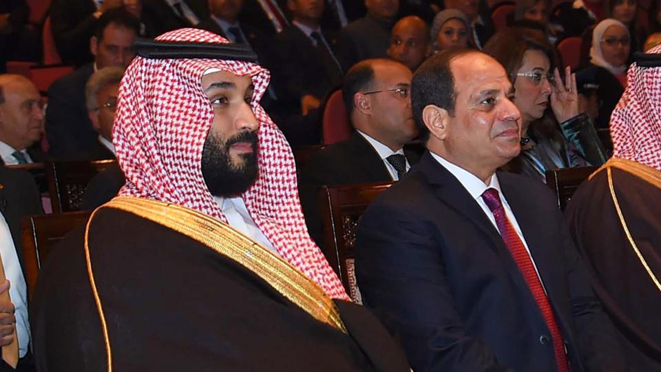 A handout picture released by the Egyptian Presidency on March 5, 2018 shows Egyptian President Abdel Fattah al-Sisi (R) and Saudi Arabia's Crown Prince Mohammed bin Salman (L) at the opera in Cairo.