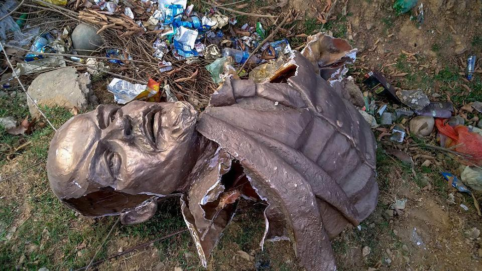 Remains of a five-feet statue of Lenin that was demolished by a payloader at Belonia in south Tripura district on Monday afternoon.