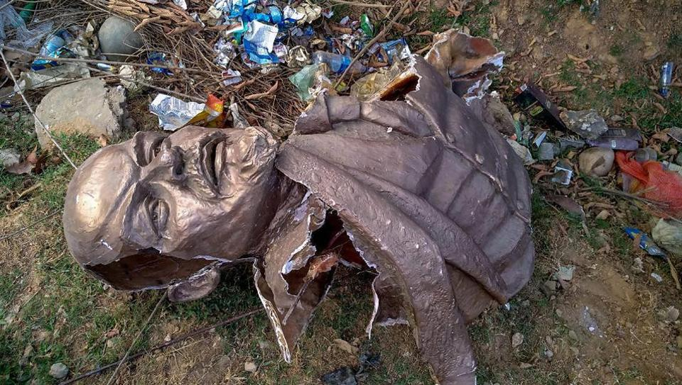 Remains of the five-feet-tall statue of Lenin which was allegedly demolished by a pay-loader at Belonia in South Tripura district on Monday afternoon