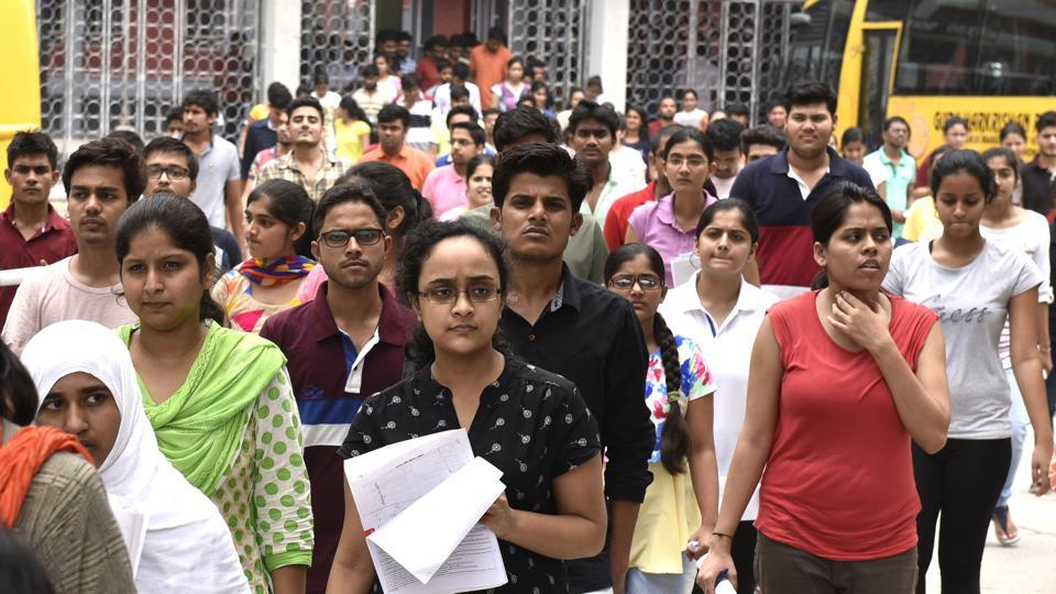 Students leave the campus of Guru Harkrishan Public school in Delhi after appearing for NEET exam.