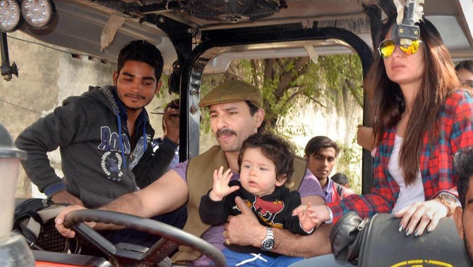 Actors Saif Ali Khan, Kareena Kapoor Khan and their son Taimur Ali Khan ride a tractor at Pataudi Palace in Gurugram.
