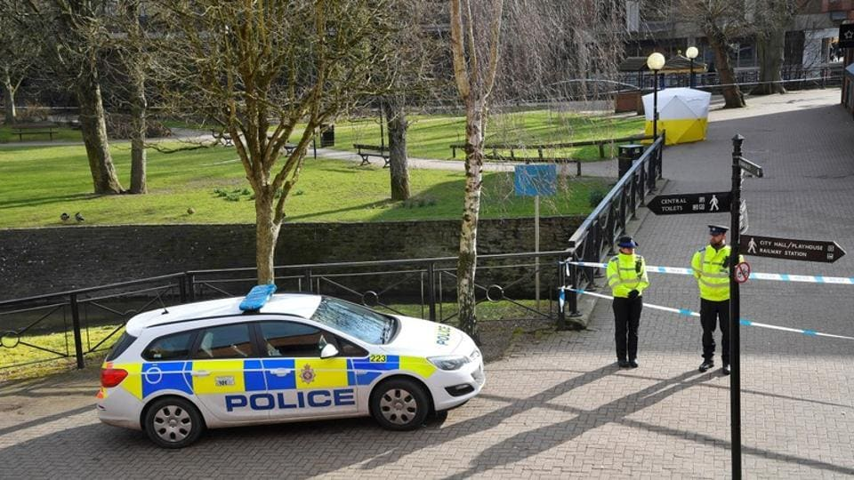 Police officers stand at the crime scene, as a tent covers a park bench on which former Russian intelligence officer Sergei Skripal, and his daughter Yulia were found unconscious after they had been exposed to an unknown substance, in Salisbury, Britain.