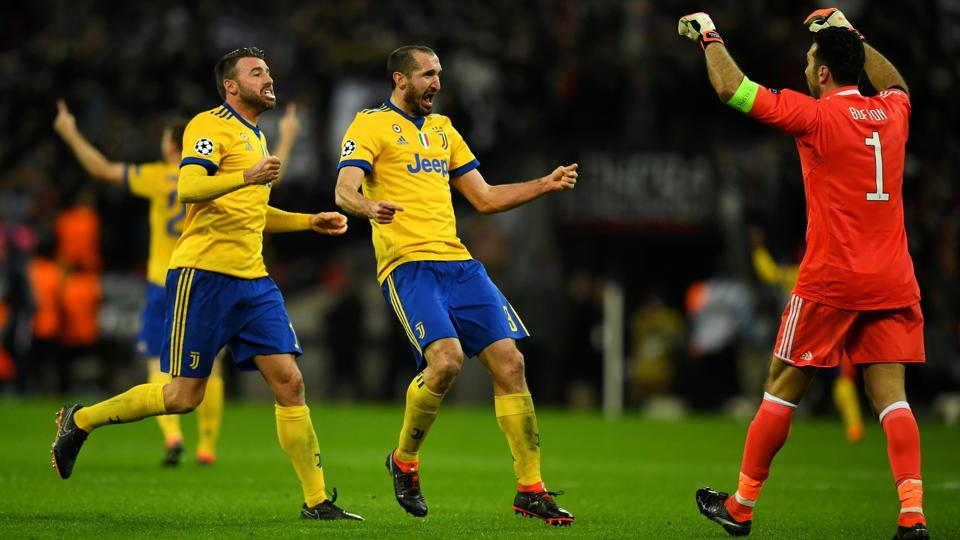 Juventus' Giorgio Chiellini and Andrea Barzagli celebrate with Gianluigi Buffon after beating Tottenham Hotspur in the Champions League Round of 16 at Wembley Stadium in London on Wednesday.