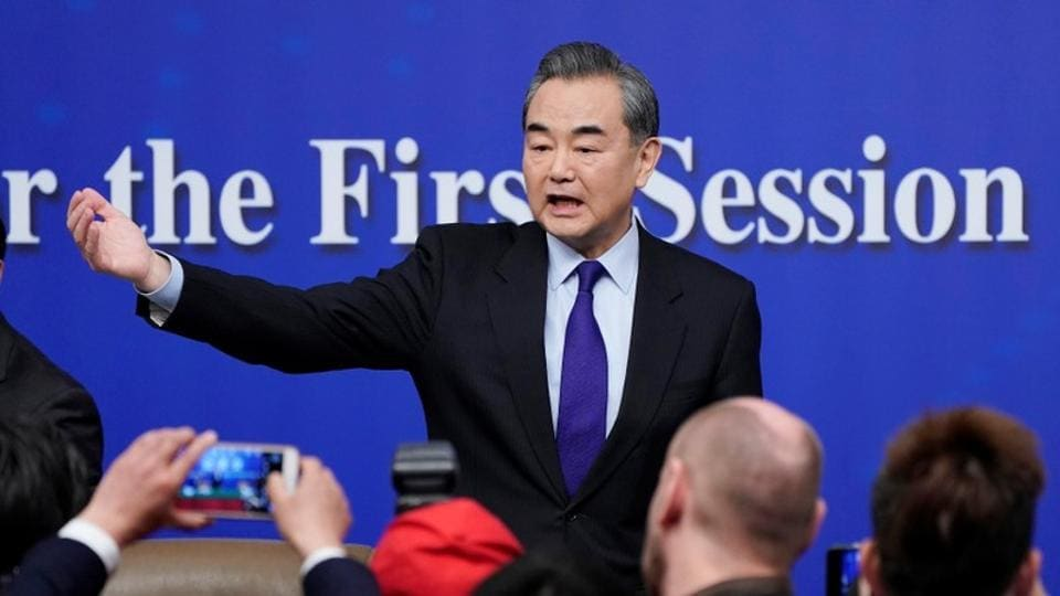 China's foreign minister Wang Yi speaks to the media during a news conference during the National People's Congress (NPC), China's parliamentary body, in Beijing, on March 8, 2018.