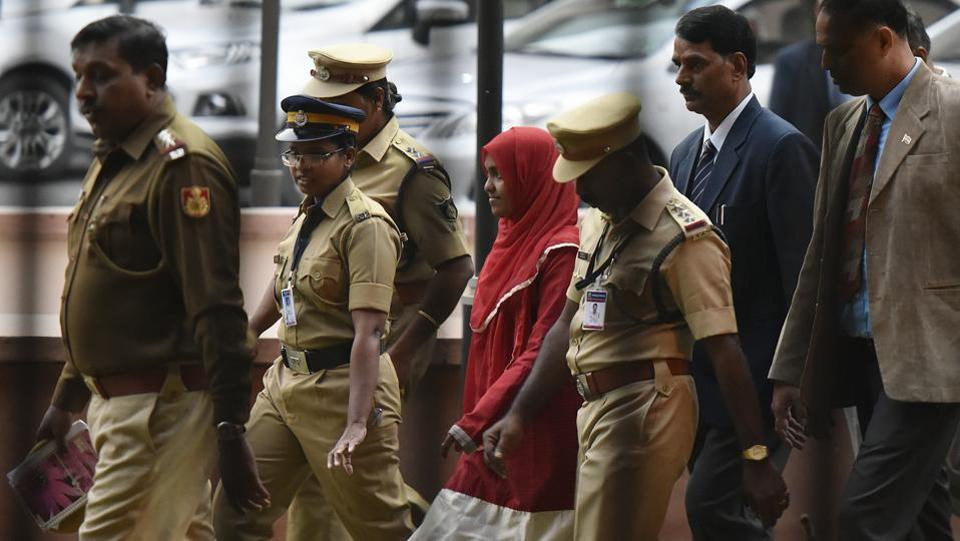 "The Supreme Court on Thursday upheld the marriage of Hadiya (C), a 26-year-old Kerala woman who converted to Islam, to Shafin Jahan, overturning a high court order that annulled the marriage as sham. Pronouncing the landmark decision that upholds a woman's right to choose her partner, the court said, ""Hadiya is at liberty to pursue her life and NIA will carry on investigation as per law."" (Vipin Kumar / HT File)"