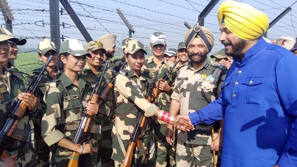 Punjab local bodies minister Navjot Singh Sidhu meets Border Security Force soldiers on the International Women's Day near Amritsar on Thursday.  (Sameer Sehgal/HT)
