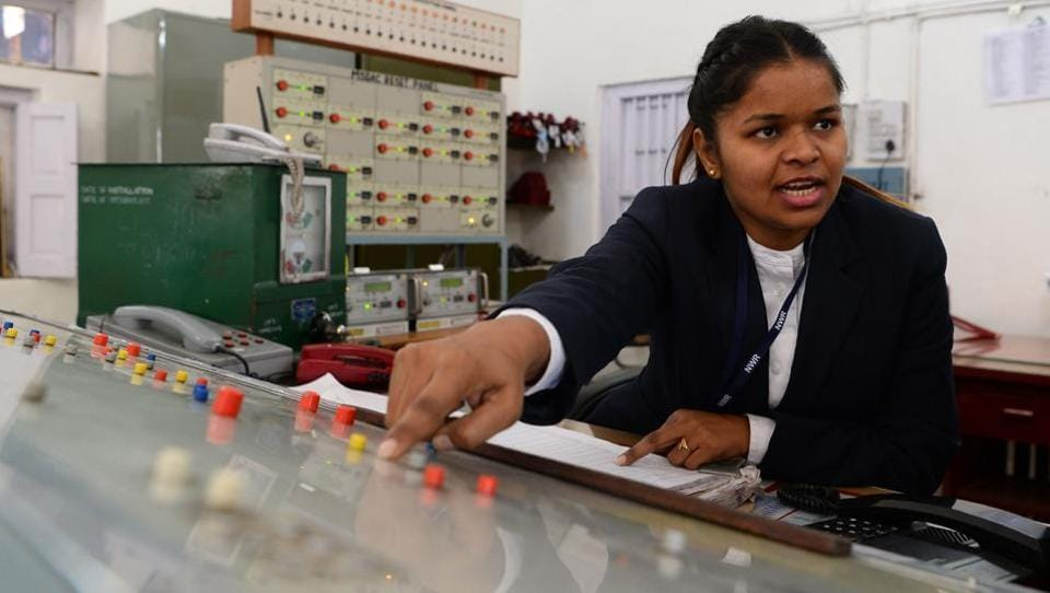 """Station supervisor Neelam Jatav explains a panel used for tracking trains at Gandhinagar railway station in Jaipur. Jatav said her job had undeniably given her """"new wings to fly"""", but she still has to deal with men sceptical of a female authority figure. A dauntless all-woman crew is breaking new ground in Rajasthan, operating a railway station inside out, taking up roles of superintendents, conductors and station masters. (Sajjad Hussain / AFP)"""