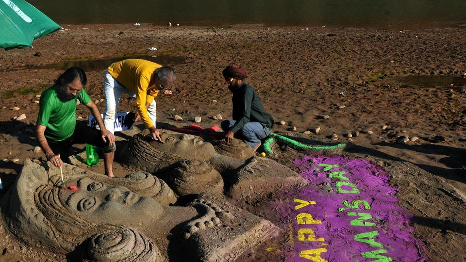 A portrait created by sand artist Suresh on International Women's Day on the bank of Tawi in Jammu on Thursday. (Nitin Kanotra/HT)