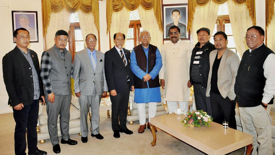 Nationalist Democratic Progressive Party leader Neiphiu Rio with BJP general secretary Ram Madhav, JD (U) elected candidate G Kaito Aye, Independent MLA Tongpang Ozukum and NDPP-BJP state officials pose with Nagaland governor PB Acharya at Raj Bhavan in Kohima.
