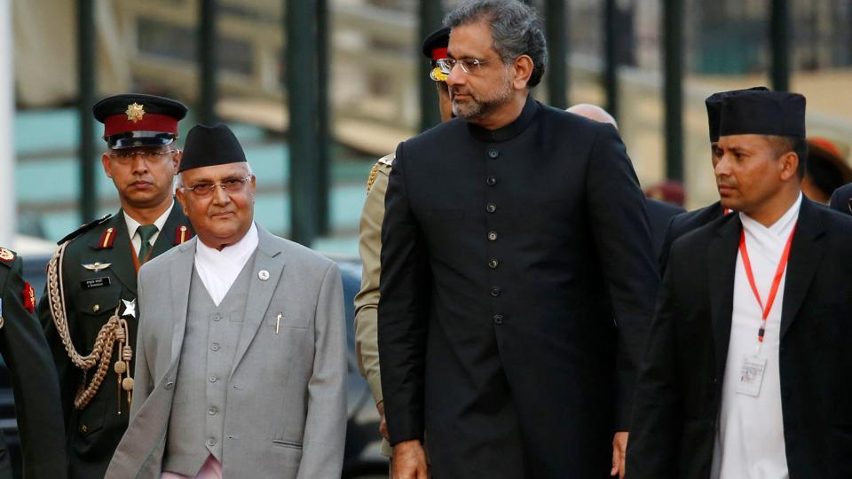 Pakistan's Prime Minister Shahid Khaqan Abbasi is welcomed by his Nepalese counterpart Khadga Prasad Sharma Oli after his arrival in Kathmandu, March 5, 2018.