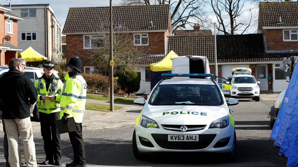 Police officers stand guard outside the home of Sergei Skripal in Salisbury, Britain, on Thursday.