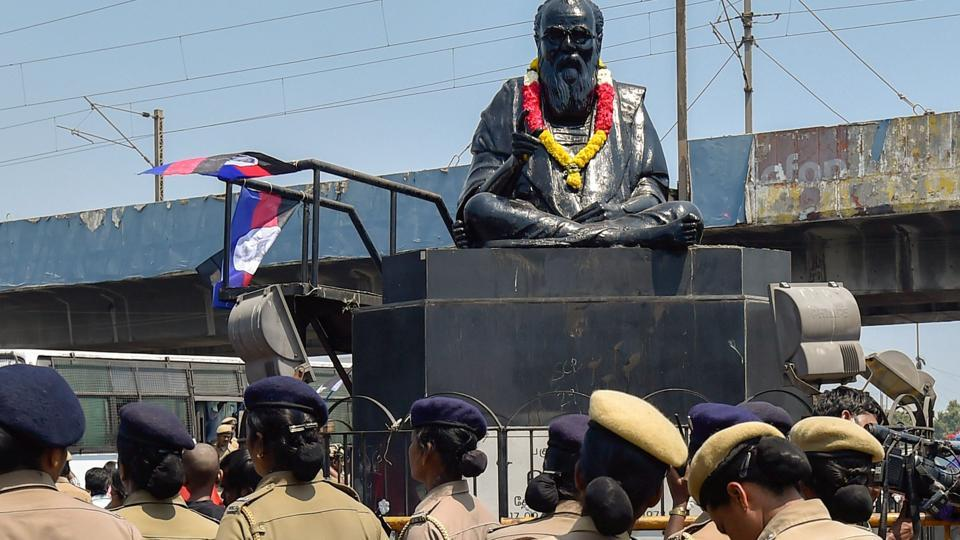Police personnel guard the statue of EV Ramasamy, popularly known as 'Periyar', in Chennai.