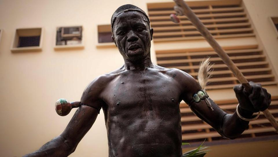 A traditional dancer from the National Ballet performs at the museum square in Bangui