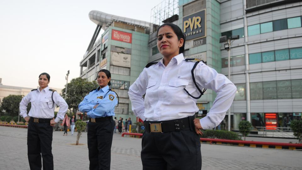 Women bouncers and security personnel at a city mall. These women ensure guests safely exit the building and get a cab home after a night of fun.