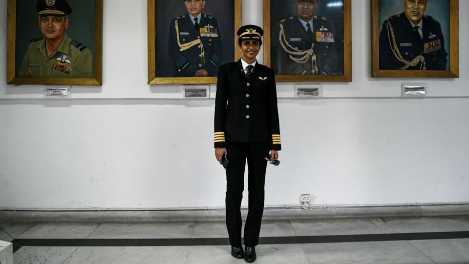 Anny Divya, 31, an Indian pilot who became the youngest woman in the world to captain the Boeing 777 aircraft, poses next to portraits of various air marshals at the Indian Air Force Museum in New Delhi. (Chandan Khanan / AFP)