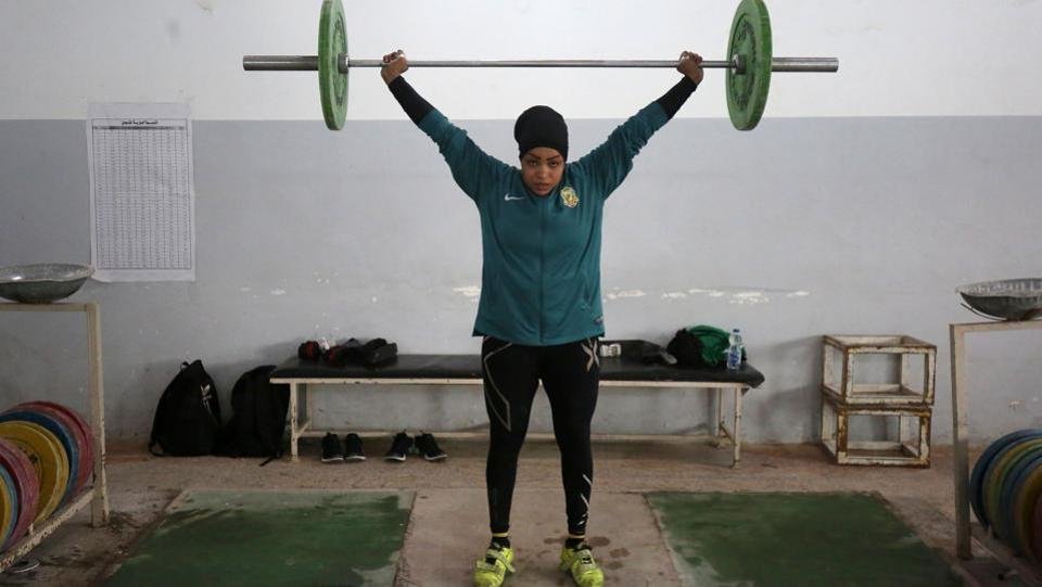 Huda Salem, a 20-year-old member of the Iraqi national weightlifting team, lifts weights as she trains at a gym in Baghdad. (Ahmad Al- Rubaye / AFP)