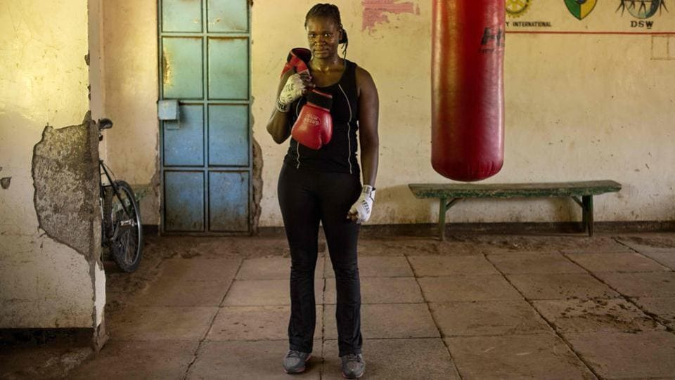 Sarah Achieng, a 31 year-old professional boxer and sports administrator poses for photographs after her training session at Kariobangi social hall gym in Nairobi. (Patricia Esteve / AFP)