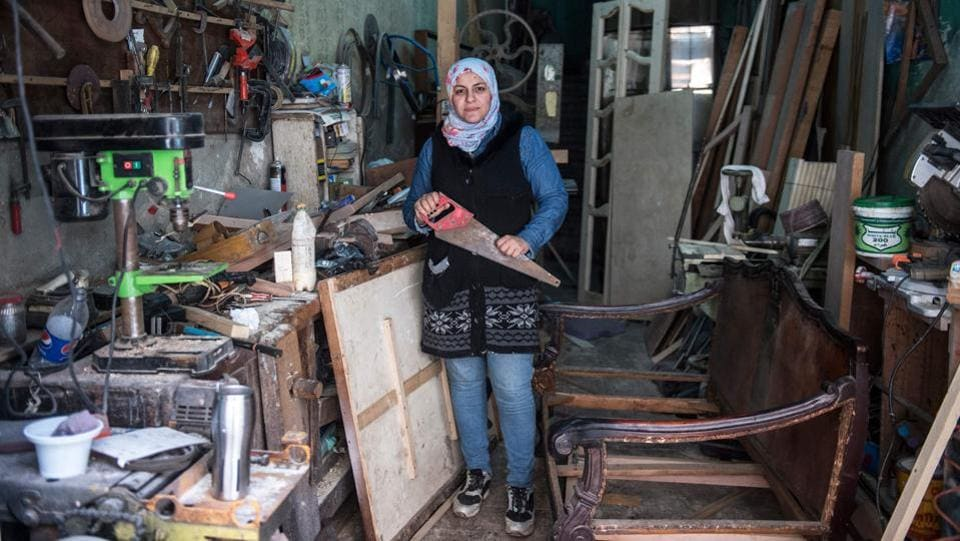 Asmaa Megahed a 31-year-old Egyptian carpenter poses for a picture at her workshop in Abdeen district in downtown Cairo. (Khaled dESOUKI / AFP)