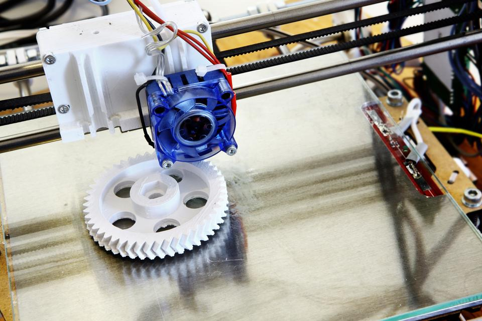 3D printer creating white plastic gear. The international science community is increasingly engaging with both the science and technology industry and government leaders.