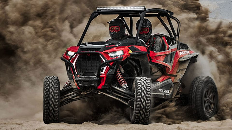 The Polaris RZR XP Turbo S' tires are larger (32 inches), the ground clearance more sizable (16 inches), and its suspension allows each wheel to travel up to 25 inches.