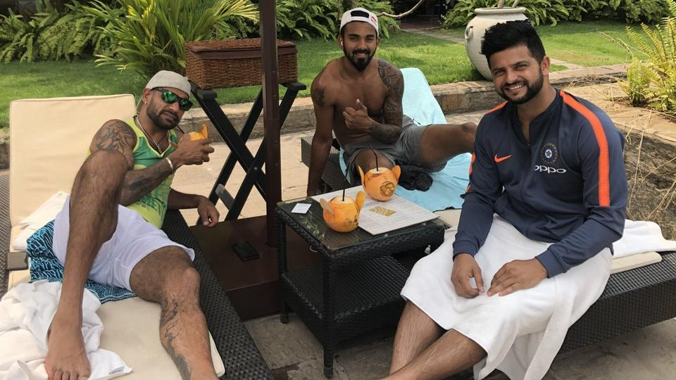 Suresh Raina chills out with teammates Shikhar Dhawan (extreme left) and KL Rahul (centre) in Colombo. India beat Bangladesh by six wickets in the Nidahas Trophy tri-nation T20 series on March 8, 2018 for their first win of the tournament.