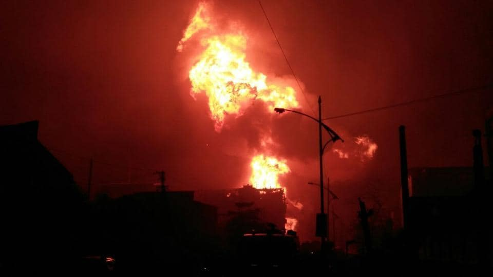 At least three people were killed and 15 injured when a series of blasts and a fire ripped through a chemical plant of a pharmaceutical company in Maharashtra's Boisar near Mumbai late on Thursday. According to preliminary reports, the blasts occurred in 25 drums containing 200 litres each of solvent at Novephene Specialities' plant at around 11:15 pm. (HT Photo)