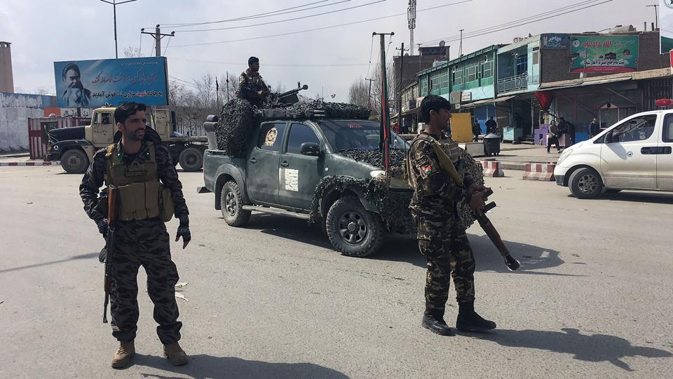 Afghan security forces keep watch near the site of an explosion in Kabul on March 9, 2018.