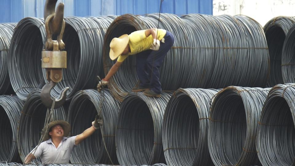 "In this August 1, 2016 file photo, labourers work in the steel market in Yichang in central China's Hubei province. China says it ""firmly opposes"" US President Donald Trump's tariff increase for imported steel and aluminium but gave no indication whether Beijing might impose its own measures in response. A government statement issued Friday, March 9, 2018, accused Trump of damaging the global trading system."