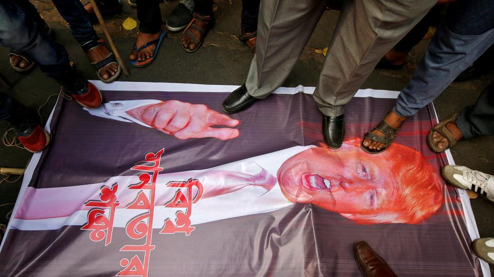 People step on a poster of US President Donald Trump during a protest against the bombing of civilians in Syria, outside the US consulate in Kolkata on March 5, 2018. (Rupak De Chowdhuri / REUTERS)
