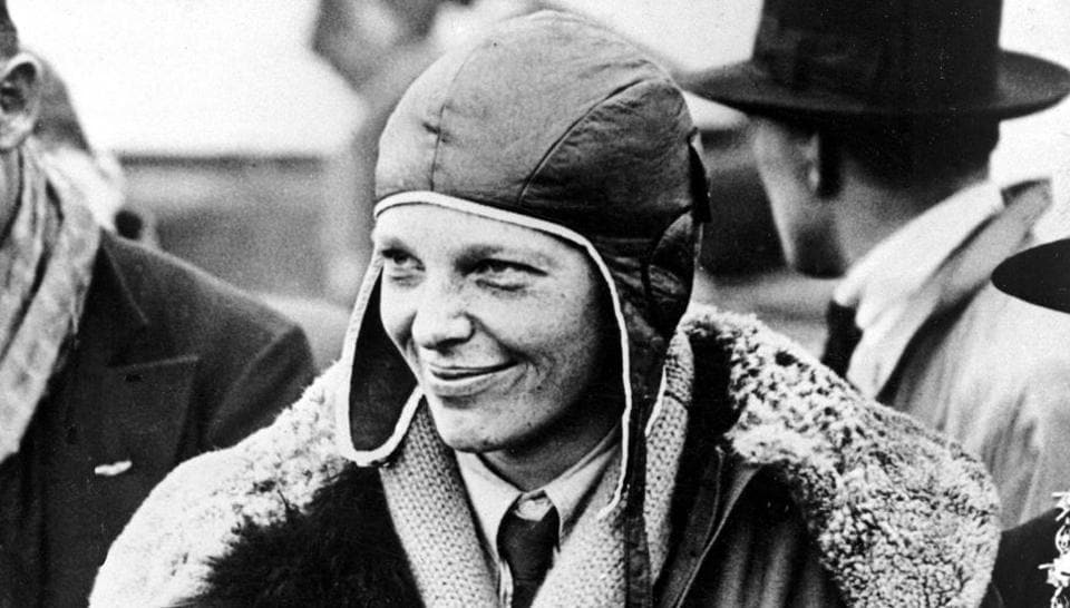 In a June 26, 1928 file photo, American aviatrix Amelia Earhart poses with flowers as she arrives in Southampton, England, after her transatlantic flight on the