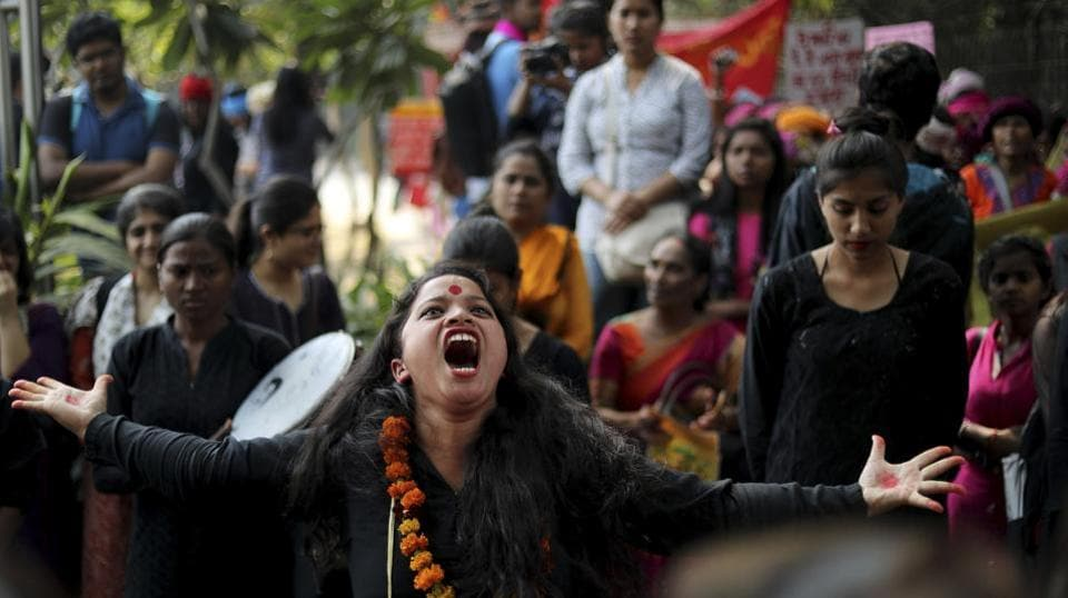 A girl performs in a street play highlighting domestic violence before the start of a march on International Women's Day in New Delhi on March 8, 2018. (Manish Swarup / AP)