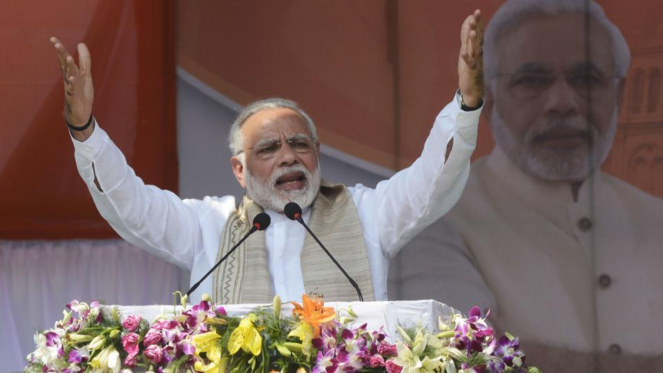 Prime Minister Narendra Modi gestures during the swearing-in ceremony of Tripura legislative assembly at Assam Rifles ground in Agartala on March 9.
