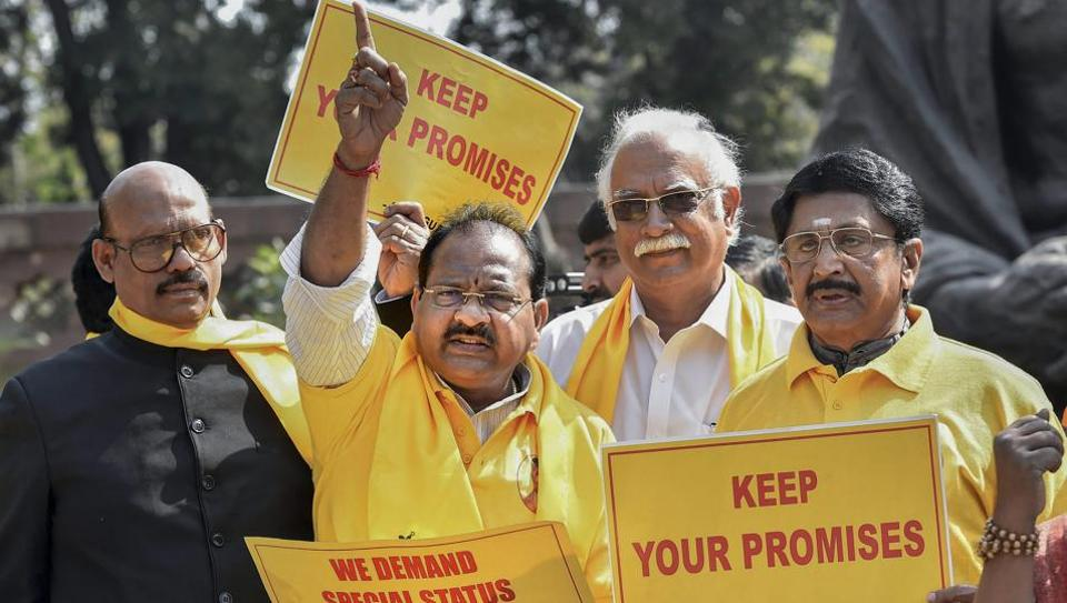 TDP MP Ashok Gajapathi Raju protests with party collagues in front of Mahatma Gandhi's statue at Parliament House demanding special status for Andhra Pradesh in New Delhi on Friday.