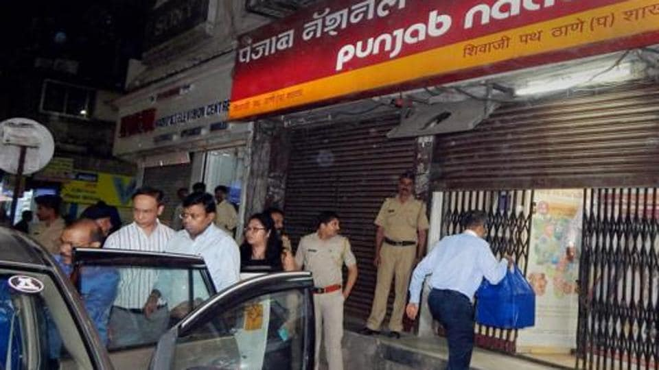 Enforcement Directorate officials outside PNB branch in Thane after they seized cash, jewellery and bonds worth several crores during a raid in relation to Nirav Modi-PNB scam in Thane on February 20, 2018.
