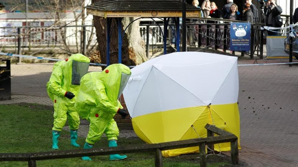 The forensic tent covering the bench where Sergei Skripal and his daughter Yulia were found is repositioned by officials in protective suits in the centre of Salisbury, Britain, on March 8, 2018.