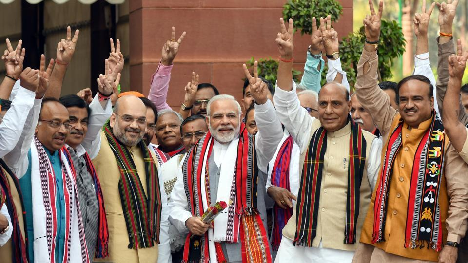 Prime Minister Narendra Modi with BJP leaders Amit Shah, Rajnath Singh, Vijay Goel, Ananth Kumar and other cabinet ministers pose for a photograph after their victory in the Assembly elections in the North-East, on the first day of the second phase of the budget session in New Delhi on March 05, 2018. (Sonu Mehta / HT Photo)