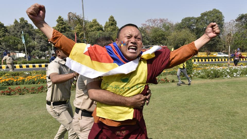 Members of Tibetian Youth Congress protest against China while commemorating the 1959 uprising in Tibet, at Chinese Embassy in New Delhi. (Sanchit Khanna /  HT Photo)