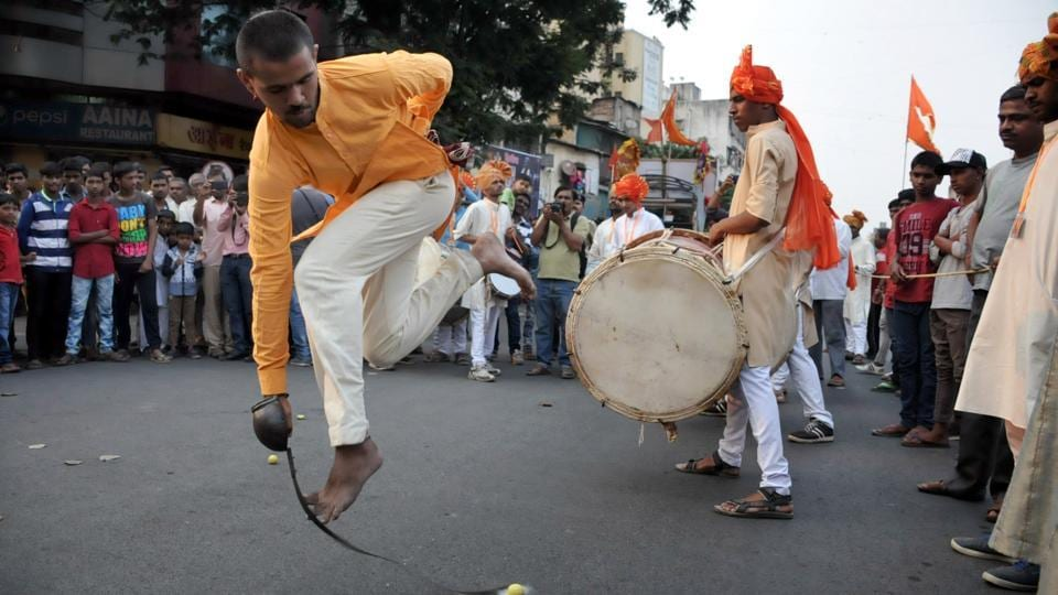 A boy performs stunts with a sword in Shivjayanti procession at Nana Peth, in Pune on March 4, 2018. (HT Photo)