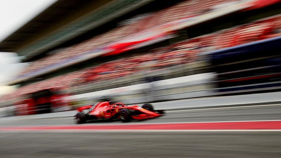 Ferrari F1 team's German driver Sebastian Vettel enters the pits at the Circuit de Catalunya in Montmelo during the third day of the second set of Formula One pre-season tests on Thursday.