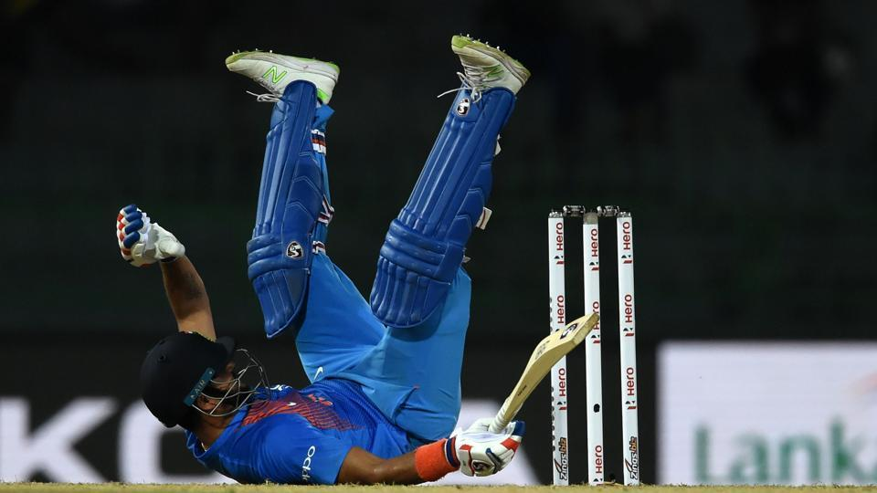 Cricketer Suresh Raina dives into his crease to complete a run during the second Twenty20 international cricket match between Bangladesh and India for the Nidahas Trophy tri-nation Twenty20 tournament at The R. Premadasa Stadium, Colombo on March 8, 2018. (Ishara S. Kodikara / AFP)