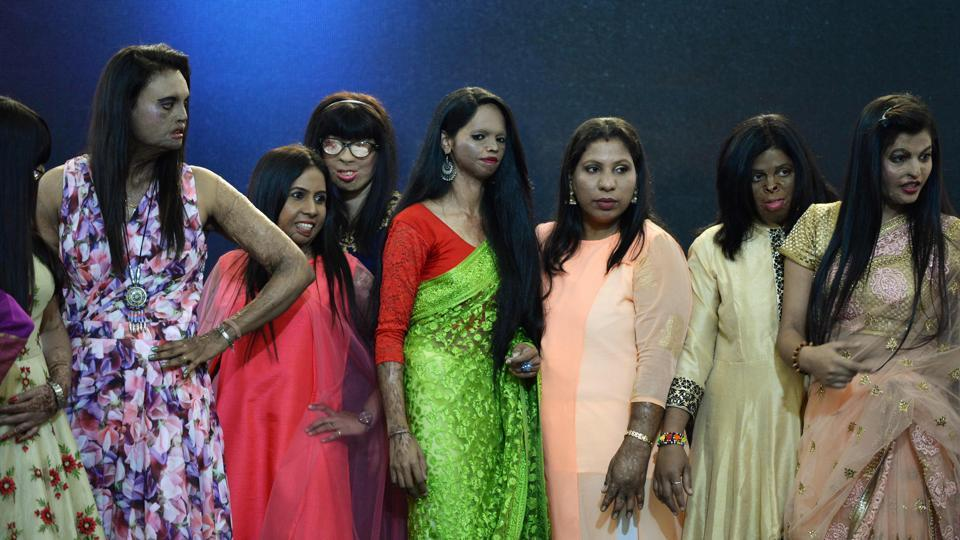Acid attack survivors pose during a fashion show as part of a campaign to spread the message 'Stop Acid Sale', in Thane on March 7, 2018, ahead of International Women's Day. (Punit Paranjpe / AFP)