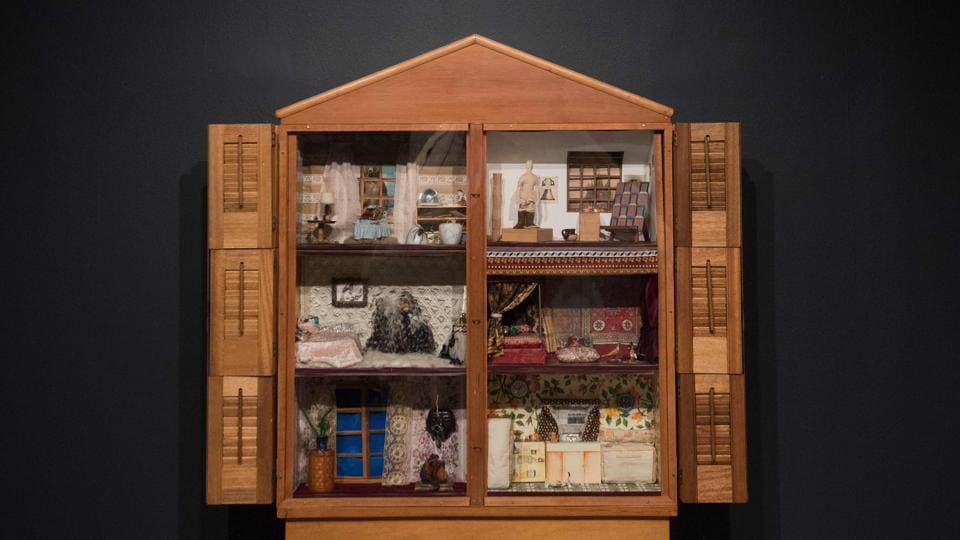 The artwork, Dollhouse, by artist Miriam Schapiro appears in the exhibition at the National Museum of Women in the Arts in Washington, DC.