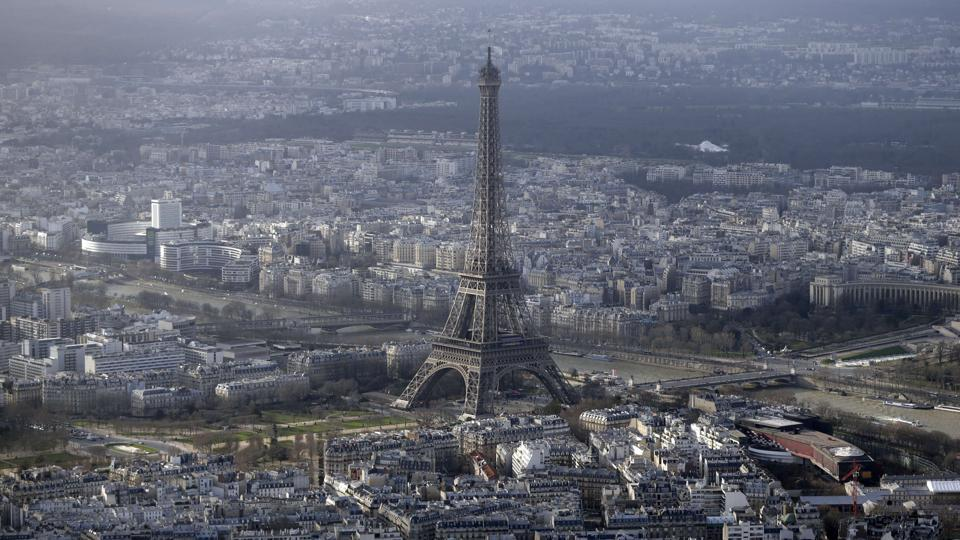 (FILES) - An aerial file photo taken on January 11, 2015 shows the Eiffel Tower in Paris. The Eiffel Tower was closed to the public in the morning on September 20, 2015 following an intrusion attempt. AFP PHOTO / KENZO TRIBOUILLARD