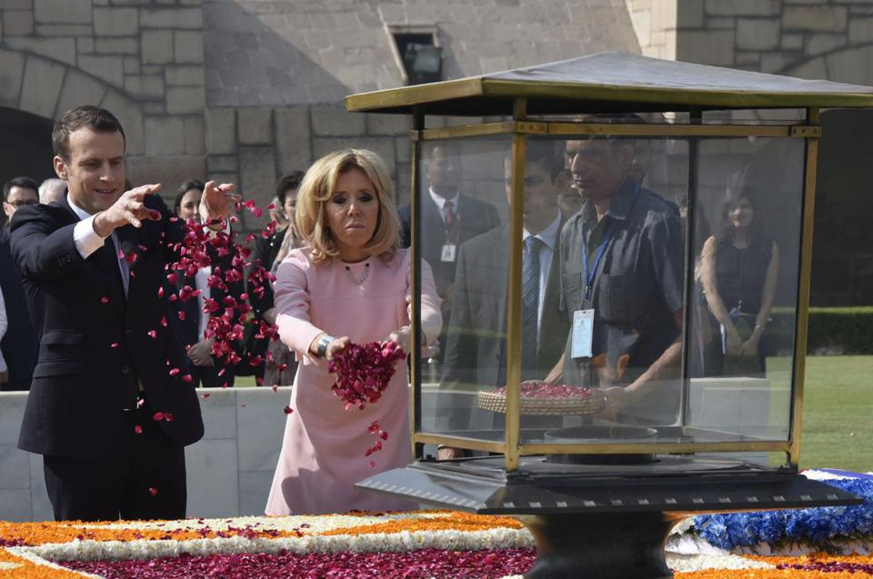 Macron and wife Brigitte offer tributes at Rajghat memorial for Mahatma Gandhi on March 10, 2018. An agreement on the Jaitapur nuclear power plant, being built with French assistance, is expected to be signed during the visit. Stepping up cooperation in the Indian Ocean region will be among top issues that will be discussed by Macron and Prime Minister Modi during today's delegation-level talks. (Vipin Kumar / HT Photo)