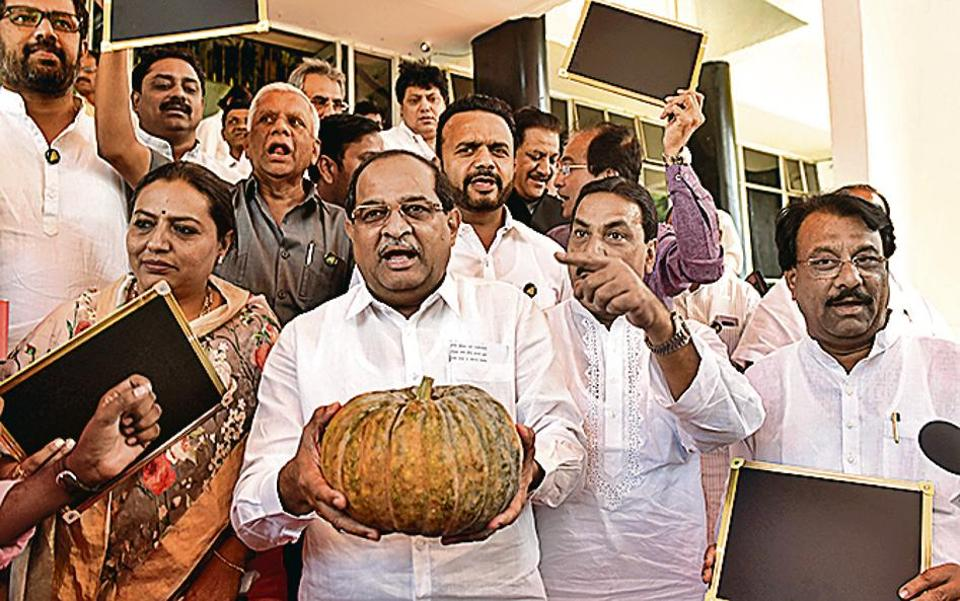Opposition leaders protest against the budget during the budget session at Vidhan Bhavan in Mumbai on Friday.