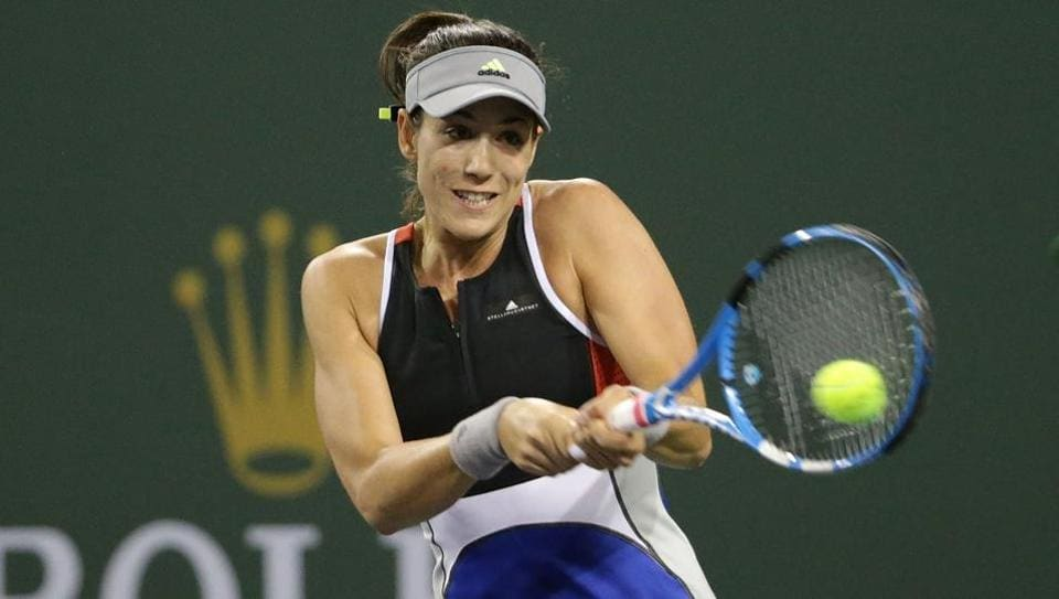 Garbine Muguruza returns to Sachia Vickery during the BNP Paribas Open at the Indian Wells Tennis Garden on March 9, 2018 in Indian Wells, California.