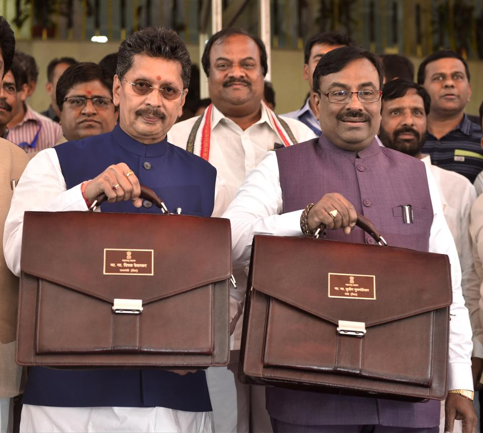 (R to L) Minister of State for Home (Rural), Finance and Planning Deepak Kesarkar along with Cabinet Minister of Finance & Planning and Forests Sudhir Mungantiwar stands for a photo opportunity before presenting the State Budget in House, during budget session at Vidhan Bhavan.